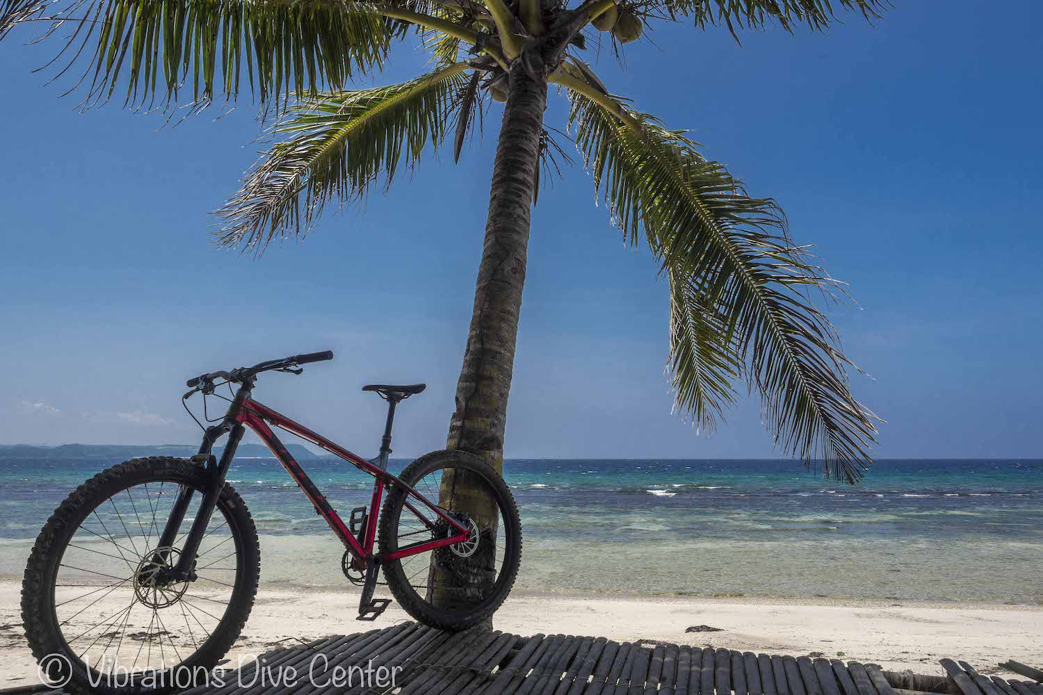 Mountain Bike on a white sand beach on Carabao Island. Informations activities and things to do on Carabao.