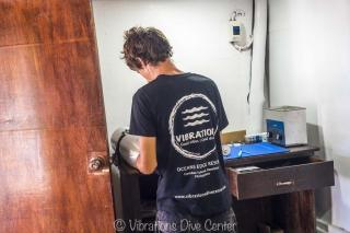 technician on dive tank visual inspection